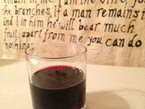 The cup of wine and the scroll about the vine.